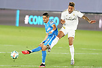 Real Madrid's Mariano Diaz (r) and Getafe CF's Faycal Fajr during La Liga match. July 2,2020. (ALTERPHOTOS/Acero)