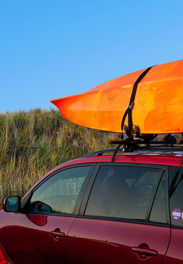 Kyak on car roof rack.