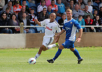 Pictured L-R: Casey Thomas of Swansea against Kye Edwards of Port Talbot. Saturday 17 July 2011<br />