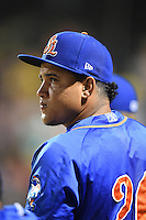 St. Lucie Mets pitcher Julian Hilario (20) in the dugout during a game against the Bradenton Marauders on April 11, 2015 at McKechnie Field in Bradenton, Florida.  St. Lucie defeated Bradenton 3-2.  (Mike Janes/Four Seam Images)