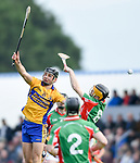 Cathal Malone of Sixmilebridge in action against Donnchadh Murphy of Clooney-Quin during their senior county final replay at Cusack park. Photograph by John Kelly.