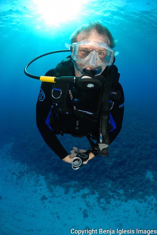 Diver doing safety stop at mid reef Molokini Maui Hawaii.