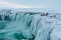 Overlooking Goðafoss waterfall in winter, Iceland.<br /> Goðafoss is located on the river Skjálfandafljót (fourth largest in Iceland) in the north of Iceland. It is one of the most spectacular waterfalls in the country.