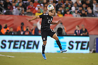 EAST RUTHERFORD, NJ - SEPTEMBER 7: Jorge Sanchez #21 of Mexico heads the ball during a game between Mexico and USMNT at MetLife Stadium on September 6, 2019 in East Rutherford, New Jersey.