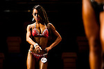 A bodybuilder competes in the Women's Model Physique category during the 2016 Hong Kong Bodybuilding Championships on 12 June 2016 at Queen Elizabeth Stadium, Hong Kong, China.  Photo by Victor Fraile / Power Sport Images