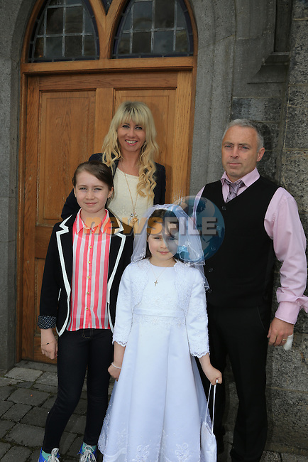 Ciara Hickey, Ciara Alison and Frank at first communion in Slane..Picture:  www.newsfile.ie ..