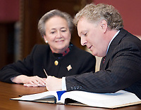 Quebec City, April 18, 2007 - Flanked by Quebec Lieutenant Governor Lise Thibault, Jean Charest signs legal document to be sworn in as the Prime at the National assembly in Quebec City April 18, 2007. The new Liberal cabinet is one of the smallest of the recent years and includes an equal number of men and women.<br /> <br /> PHOTO :  Francis Vachon - Agence Quebec Presse