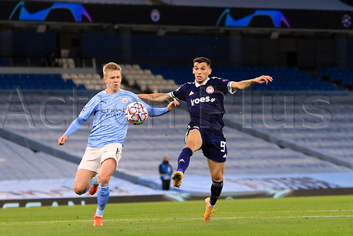 3rd November 2020; City of Manchester Stadium, Manchester, England. UEFA Champions League group stages, Manchester City versus Olympiacos;  Lazar Randjelovic (OL) challenges Oleksandr Zinchenko Manchester City