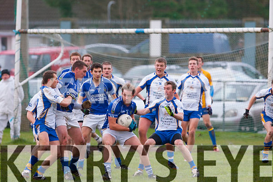 Surrounded<br /> --------------<br /> After a late injury time free that hit the post kicked by Mike Frank Russel to send the game into extra time,Tommy Callaghan,Laune Rangers caught the rebound but the Keel defence swarmed around him as the ref blew the whistle when the sides met in the replay of the Mid Kerry Championship last Sunday afternoon,