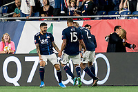 FOXBOROUGH, MA - SEPTEMBER 29: Gustavo Bao #7 of New England Revolution celebrates his goal with teammates during a game between New York City FC and New England Revolution at Gillette Stadium on September 29, 2019 in Foxborough, Massachusetts.