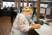 Kathy Hanson files for an alderman position in Avoca, Thursday, July 30, 2020 at the Benton County Administration Building in Bentonville. Thursday was the second day of filing for office in Benton County. Check out nwaonline.com/200731Daily/ for today's photo gallery. <br /> (NWA Democrat-Gazette/Charlie Kaijo)