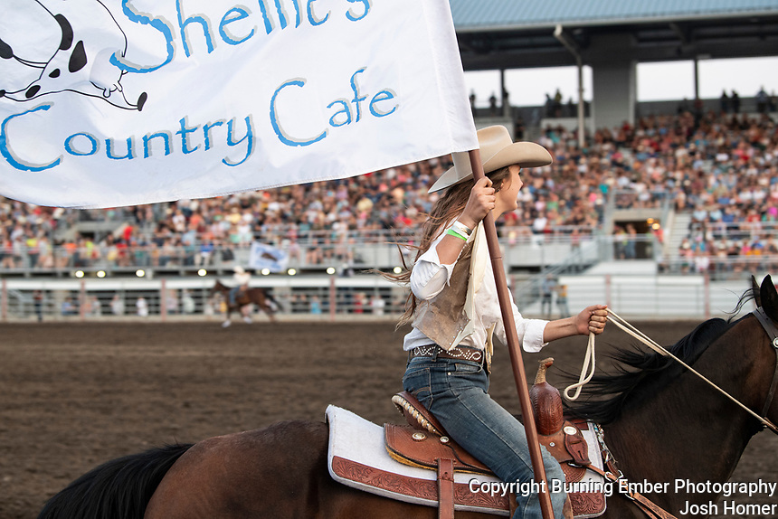 Sponsor Flags at the Last Chance Stampede 1st perf 2021.  Photo by Josh Homer.  All rights reserved and copyrighted by Burning Ember Photography.  Photo Credit must be given on all uses.