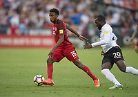 Commerce City, CO - Thursday June 08, 2017: Kellyn Acosta, Jamille Boatswain during a 2018 FIFA World Cup Qualifying Final Round match between the men's national teams of the United States (USA) and Trinidad and Tobago (TRI) at Dick's Sporting Goods Park.