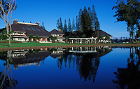 Buildings and grounds reflected in a pond on the grounds of the lodge at Koele, Lanai