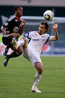 Thabiso Khumalo (17) of D.C. United collides with Santiago Hirsig (10)  of the Kansas City Wizards  at RFK Stadium in Washington, DC.  D.C. United defeated the Kansas City Wizards, 2-1.