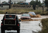 Pictured: Cars travel through the flood.<br /> Re: Five people have reportedly died and severe damage caused by heavy rain and flash flooding in the area of Mandra, near Athens, Greece. Wednesday 15 November 2017
