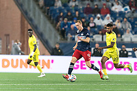 FOXBOROUGH, MA - AUGUST 4: Adam Buksa #9 of New England Revolution dribbles as Anibal Godoy #20 of Nashville SC defends during a game between Nashville SC and New England Revolution at Gillette Stadium on August 4, 2021 in Foxborough, Massachusetts.