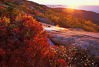 The sun rises over the Atlantic Ocean from Cadillac Mountain, Acadia National Park, Maine