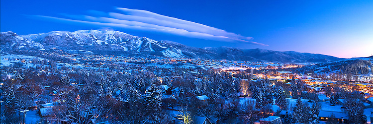 A panoramic view of Oldtown Steamboat Springs and Mt. Werner at dusk.