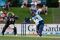 23rd February 2021, Christchurch, New Zealand;  Heather Knight  of England hits a 4 watched by Katey Martin of New Zealand at Wicketkeeper during the 1st ODI Cricket match, New Zealand versus England,Hagley Oval, Christchurch, New Zealand