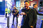 """© Joel Goodman - 07973 332324 . 17/12/2016 . Manchester , UK . A man carries a woman on his back along Withy Grove . Revellers out in Manchester City Centre overnight during """" Mad Friday """" , named for being one of the busiest nights of the year for the emergency services in the UK . Photo credit : Joel Goodman"""