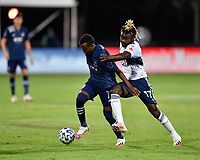 LAKE BUENA VISTA, FL - JULY 26: Gadi Kinda of Sporting KC is pressured by Leonard Owusu of Vancouver Whitecaps FC during a game between Vancouver Whitecaps and Sporting Kansas City at ESPN Wide World of Sports on July 26, 2020 in Lake Buena Vista, Florida.