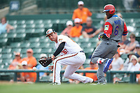 Baltimore Orioles first baseman Trey Mancini (67) fields a throw as Starling Marte (6) runs through the bag during a Spring Training exhibition game against the Dominican Republic on March 7, 2017 at Ed Smith Stadium in Sarasota, Florida.  Baltimore defeated the Dominican Republic 5-4.  (Mike Janes/Four Seam Images)