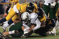 WVU defense sacks USF quarterback B.J. Daniels.  The West Virginia Mountaineers defeated the South Florida Bulls 20-6 on October 14, 2010 at Mountaineer Field, Morgantown, West Virginia.