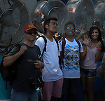 Fans try to stay cool in the record breaking heat at the Australian Open in Melbourne Australia