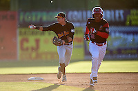 West Virginia Black Bears second baseman Tyler Leffler (59) checks the runner on third as he chases Jhonny Santos (32) back to first in a run down during a game against the Batavia Muckdogs on June 30, 2016 at Dwyer Stadium in Batavia, New York.  Batavia defeated West Virginia 4-3.  (Mike Janes/Four Seam Images)