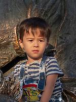 Junge auf Statue des Nasreddin, Buchara, Usbekistan, Asien<br /> Boy at statue of Nasreddin, Historic City of Bukhara, Uzbekistan, Asia