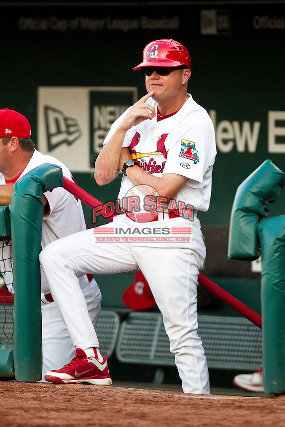 Manager Mike Shildt (8) of the Springfield Cardinals stands on the stairs of the dugout during a game against the Arkansas Travelers at Hammons Field on May 5, 2012 in Springfield, Missouri. (David Welker/Four Seam Images)