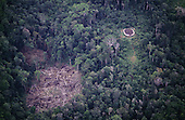 Roraima State, Brazil. Aerial view of a large Yanomami Indian Yano house with newly cleared agricultural patch nearby.