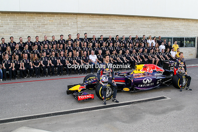 SEBASTIAN VETTEL (01) driver of the Infiniti Red Bull Racing car and DANIEL RICCIARDO (03) driver of the Infiniti Red Bull Racing Renault car pose with the Red Bull car and team before the Formula 1 United States Grand Prix race at the Circuit of the Americas race track in Austin,Texas.