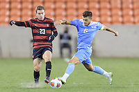 Houston, TX - Friday December 9, 2016: Sam Werner (23) of the Stanford Cardinal battles for the ball with Colton Storm (6) of the North Carolina Tar Heels at the NCAA Men's Soccer Semifinals at BBVA Compass Stadium in Houston Texas.