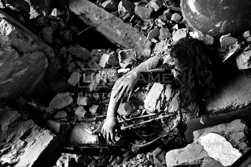 The body of a victim is seen amid the rubble after an eight-storey building collapsed in Savar, near Dhaka, Bangladesh