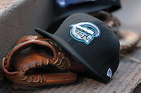 Syracuse Chiefs hat and glove during a game vs. the Buffalo Bisons at Coca-Cola Field in Buffalo, New York;  August 30, 2010.  Syracuse defeated Buffalo 4-1.  Photo By Mike Janes/Four Seam Images