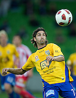 MELBOURNE, AUSTRALIA - OCTOBER 23: Zenon Caravella of Gold Coast watches the ball during the A-League match between the Melbourne Heart and Gold Coast United at AAMI Park on October 23, 2010 in Melbourne, Australia. (Photo by Sydney Low / Asterisk Images)
