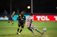 LAKE BUENA VISTA, FL - JULY 16: Kyle Duncan #6 of the New York Red Bulls kicks the ball during a game between New York Red Bulls and Columbus Crew at Wide World of Sports on July 16, 2020 in Lake Buena Vista, Florida.