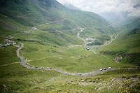 peloton down towards the valley over the top of the Col du Tourmalet (HC/2115m/17.1km/7.3%)<br /> <br /> 2014 Tour de France<br /> stage 18: Pau - Hautacam (145km)