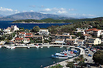 Greece, Corfu, Kassiopi: View over harbour with harbourside Tavernas and holiday apartments