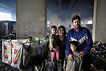Nevrigda Zitkova and her husband Arden Dasi, with two of their children, lived under a bridge in a Roma settlement in Belgrade, Serbia, when this photo was taken in February 2012. They are refugees from Kosovo. The families that lived here, most of whom survive from recycling cardboard and other materials, were forcibly evicted in April 2012. Many were moved into metal shipping containers on the edge of Belgrade..
