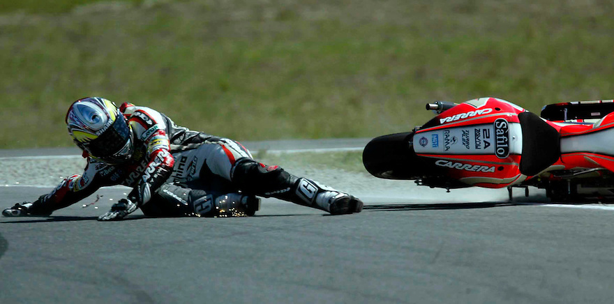 MotoGP at Phillip Island.  Randy De Puniet throws up a shower of sparks as he crashes.