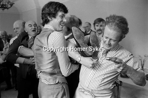 Hocktide. Hungerford, Berkshire 1973. 'Shoeing the Colt' takes place after lunch. A 'colt' is a person who has not attended the lunch before, after being over- powered, a horse-shoe nail is supposedly driven into the heel of his shoe, until he calls a halt by crying 'punch'.