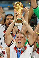 Bastian Schweinsteiger of Germany lifts the World Cup trophy after winning the 2014 final