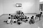 Students of Sukma Football Academy watching movie on television.Sukma, Chattisgarh, India. Arindam Mukherjee