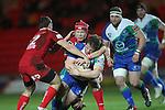 Scarlets number 8 Kieran Murphy hauls down Connacht hooker Jason Harris-Wright..Scarlets v Connacht.Parc y Scarlets.Rabo Pro12.08.02.13.©Steve Pope-SPORTINGWALES
