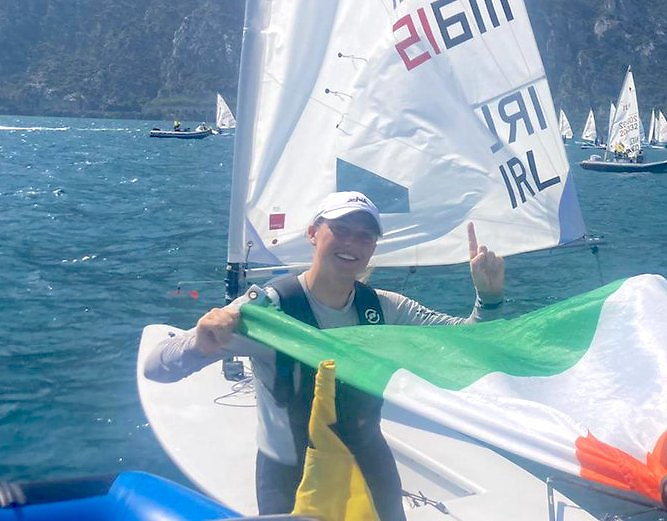 Howth's Eve McMahon celebrates with the Irish tricolour coming ashore at Lake Garda having won the Radial Youth Worlds (girls division)