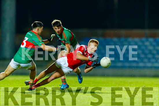 David Mangan, Mid Kerry in action against Niall Donohue, East Kerry during the Kerry County Senior Football Championship Final match between East Kerry and Mid Kerry at Austin Stack Park in Tralee on Saturday night.
