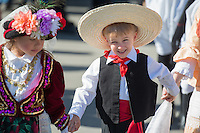 """Little Stars of the North"" (Asterakia Tou Vora) dancer James Hillhouse heads for the stage for traditional Greek dancing during the Holy Transfiguration Greek Orthodox Church's 21st annual Greek Festival."